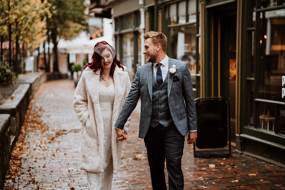 Nicola Dawson Photography | Glamorous wedding couple, bride and groom walking through town, secret wedding