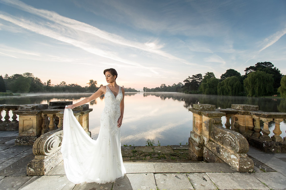 Jeff Oliver Photography | Hever Castle Wedding, bride standing on the loggia at Hever, Hever Castle Italian Gardens wedding, wedding at sunrise