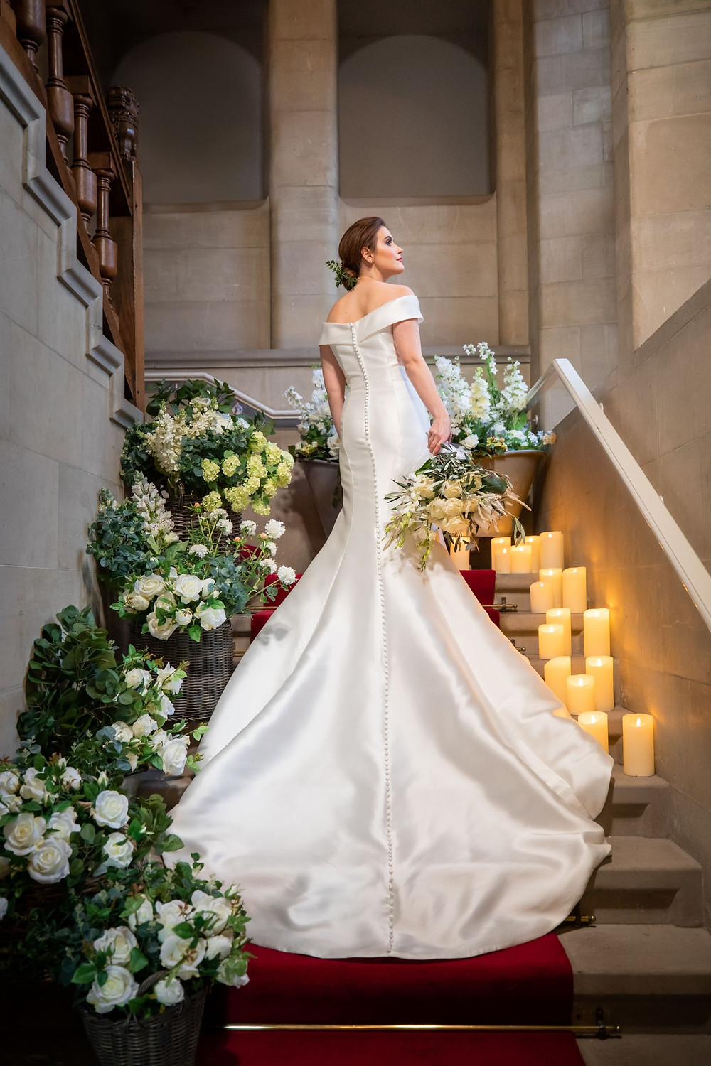 Jeff Oliver Photography   White Wedding, white and green wedding colours, bride ascending stairs with long train flowing down