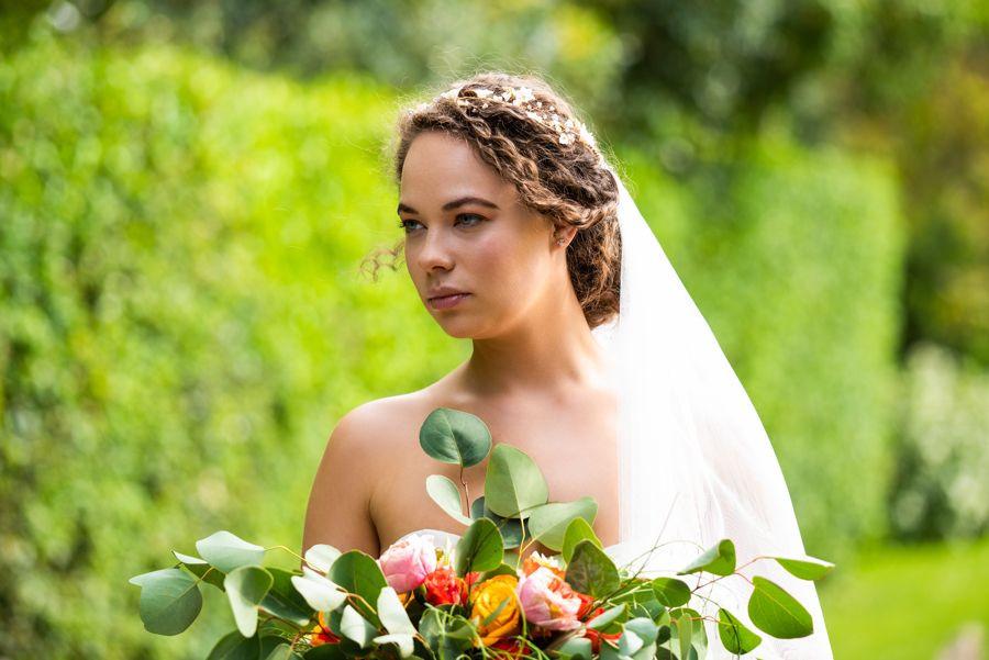 Matt & Kizzy Wedding Photography | Bride holding country-style wedding flowers bouquet