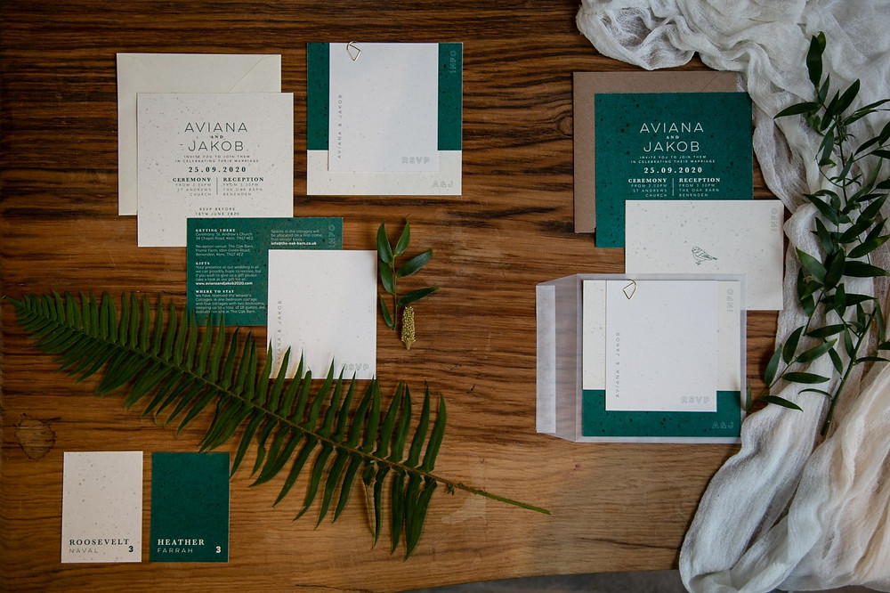 Green and white eco-friendly wedding stationery