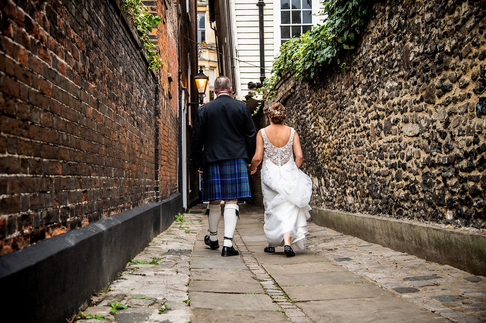 Noteworthy Photography and Film | Bride and groom walking away