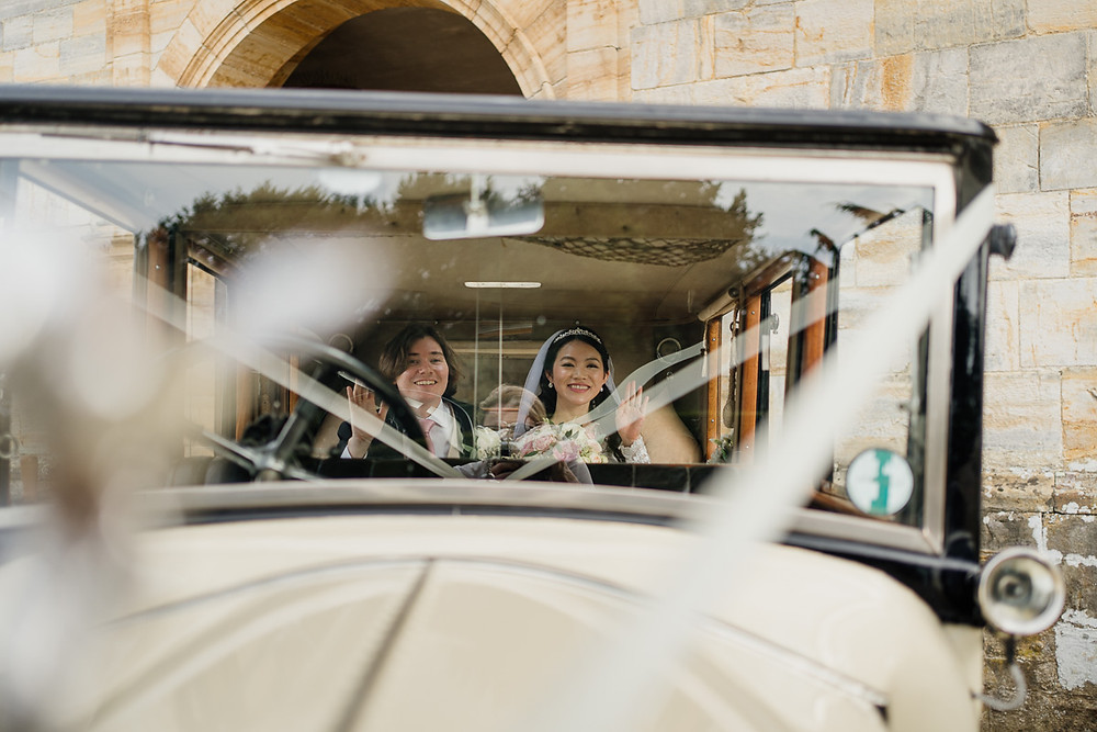 Penny Young Photography | Bride and groom leaving wedding in vintage car