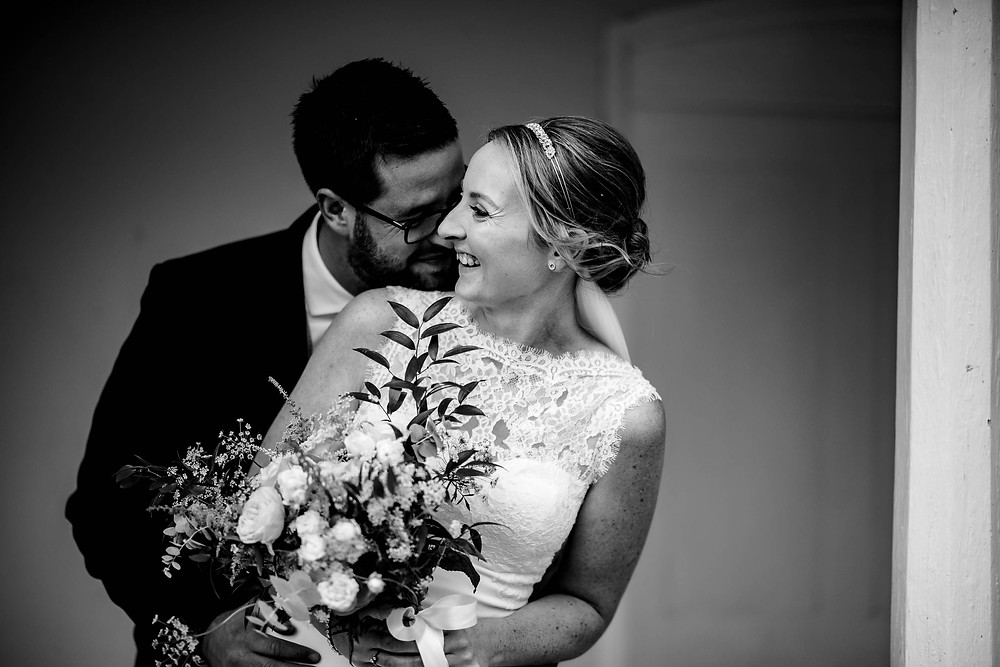 Matt Trott Photography | Black and white image of groom standing with his arms around the bride