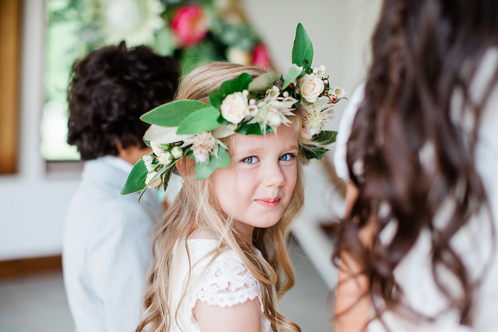 Flower girl wearing elaborate flower crown