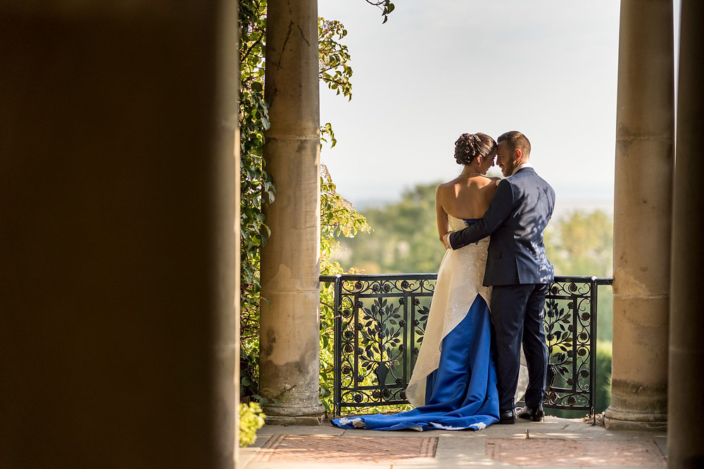 Jeff Oliver Photography | Bride and groom standing together outside, white and blue wedding dress