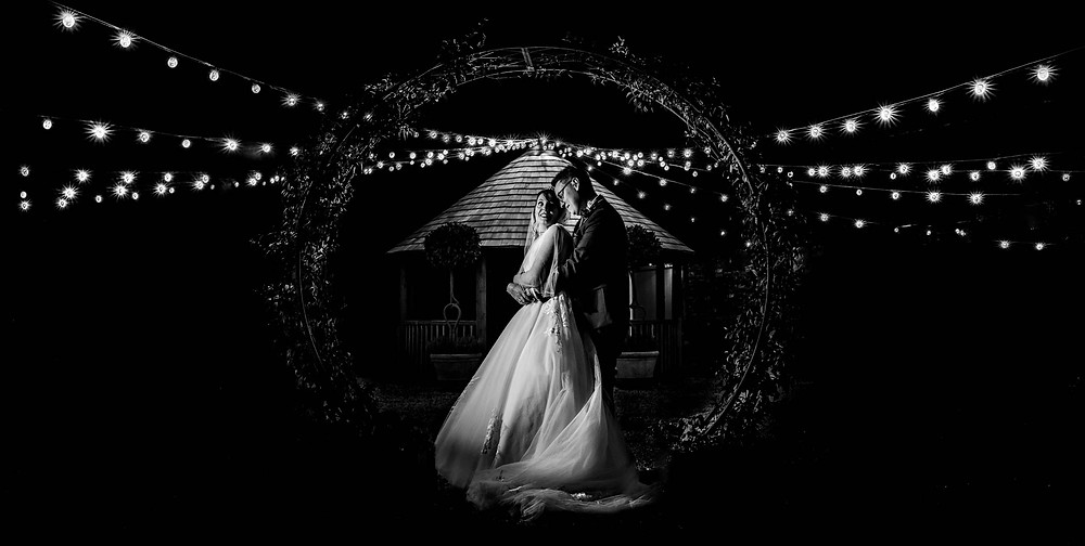 © Matt Trott Photography | black and white shot of bride and groom under floral moongate / moonarch
