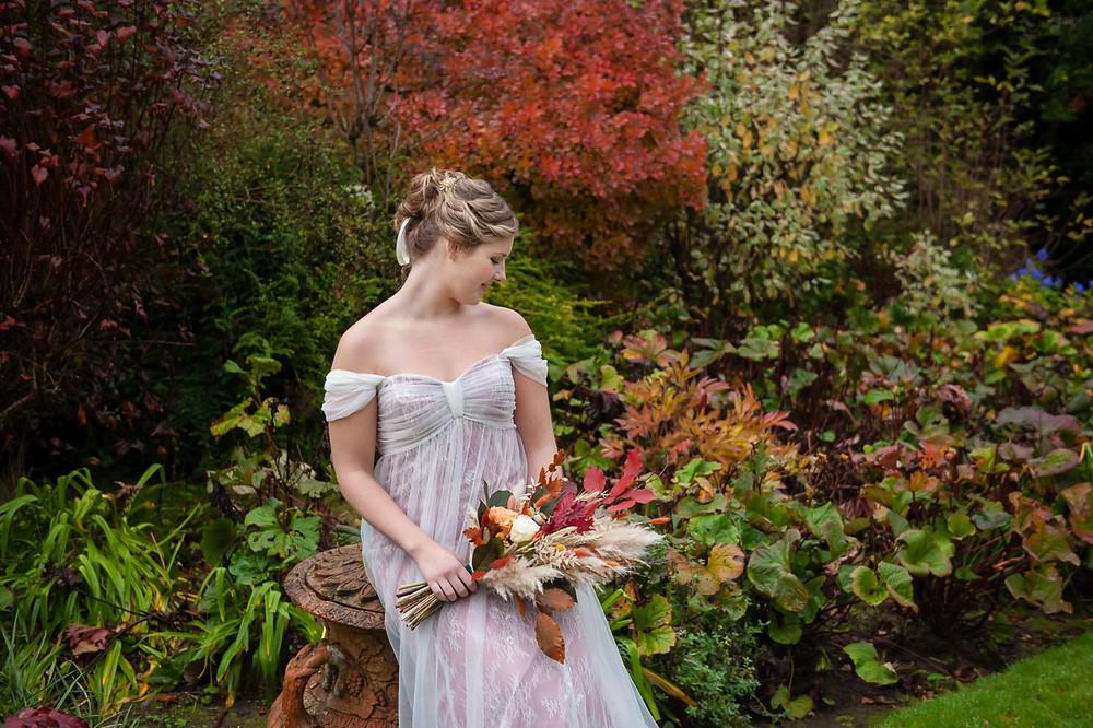 Kat Forsyth Photography   Regency Wedding, Autumn Wedding Inspiration, Jane Austen Wedding, Bridgerton Wedding, empire line dress, woman sitting in gardens