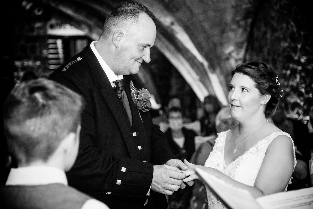 Noteworthy Photography and Film | Black and white image of bride and groom exchanging wedding rings