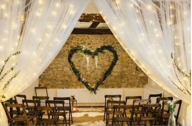 The Bull, Wrotham, Kent wedding venue, drapes with twinkly lights and heart backdrop