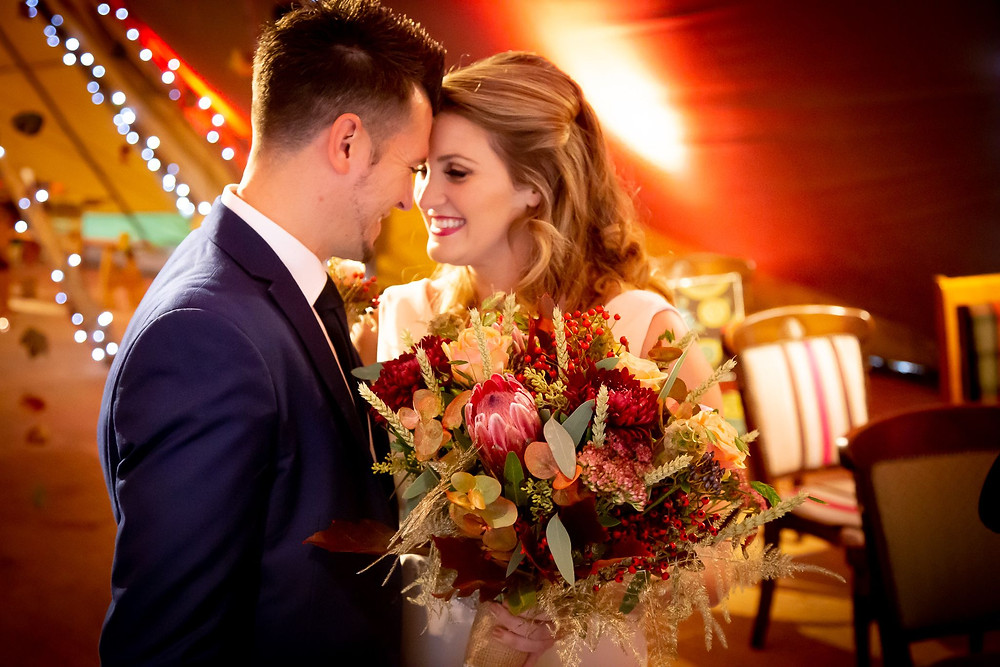 Strawberry Photography | Bride and groom in tipi, autumnal wedding, autumn flowers