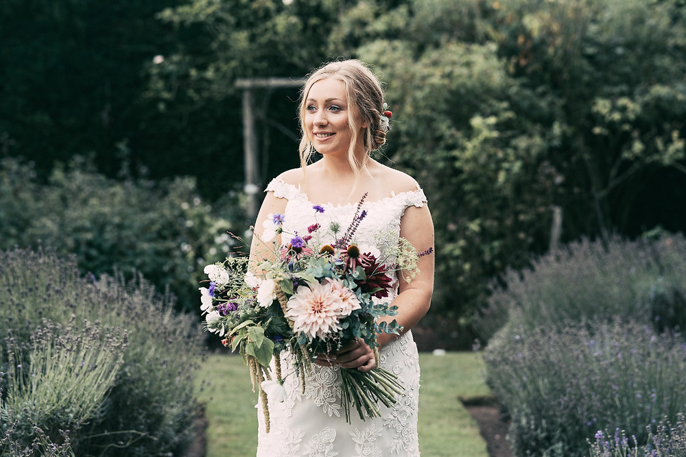 Tom Cullen Photography | Kent garden wedding, bride standing in garden with bridal bouquet