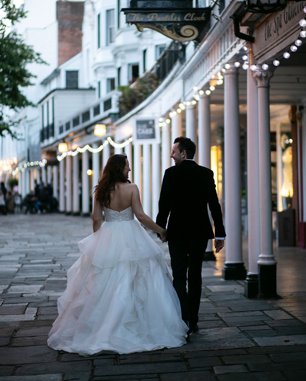 Bride and groom walking along The Pantiles in Tunbridge Wells
