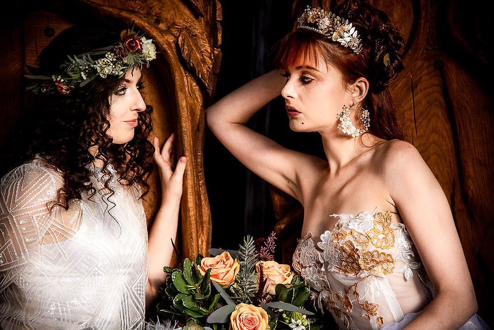Two brides looking at each other, edgy autumnal wedding brown and gold