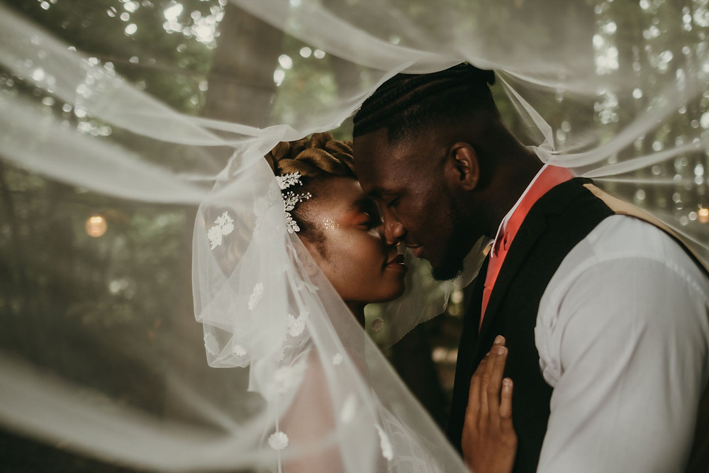 Tom Jeavons Photography | gorgeous shot of the veil over the bride and groom in the woods