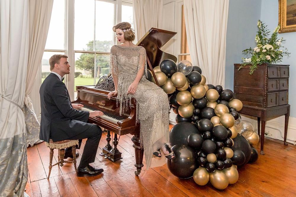 Emma Stokes Photography | Gatsby Wedding Ideas, 1920s wedding inspiration, Nurstead Court, Kent Wedding Venue, bride sitting on piano
