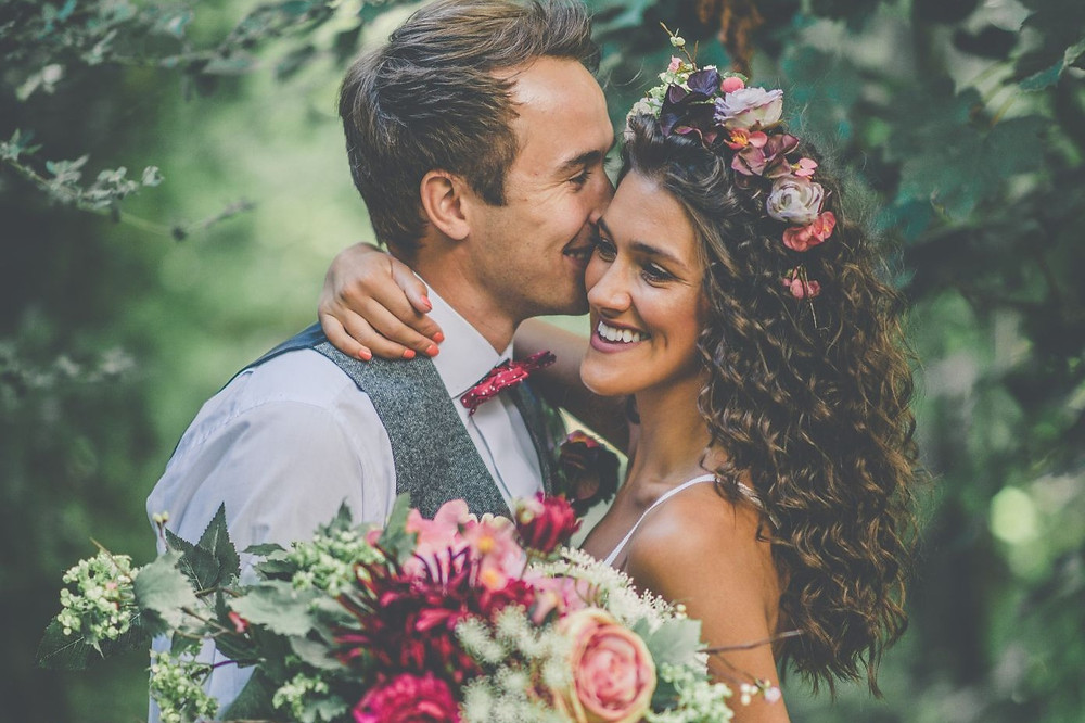 Fleur Challis Photography | Bride and groom hugging at wedding, bridal flower crown, boho wedding