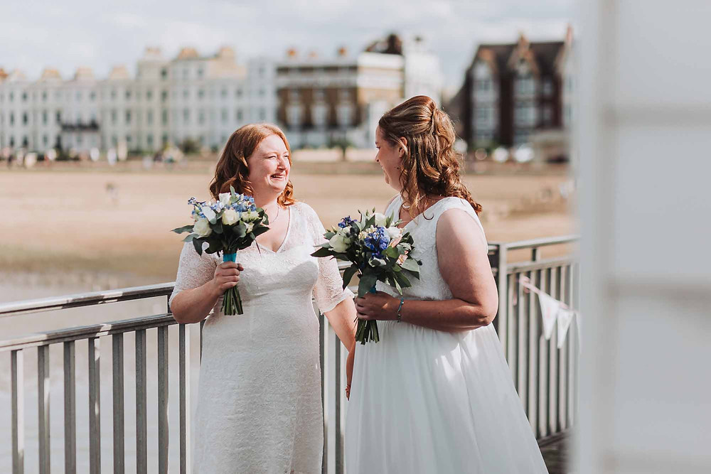 Colin Sherlock Photography | Two brides at their seaside wedding at the beach