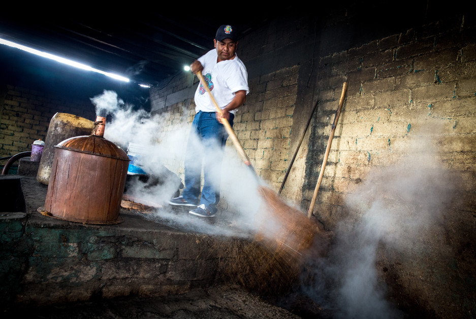 Beto Morales, owner of Wahaka Mezcal, unloads agave fiber from his copper still in San Dionisio Ocotepec, Oaxaca.