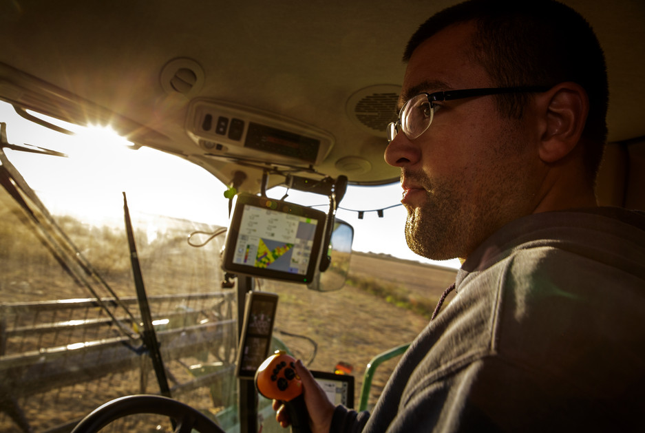 Kyle Galloway, Meghan's husband, harvest a field of soybeans soley by eye.