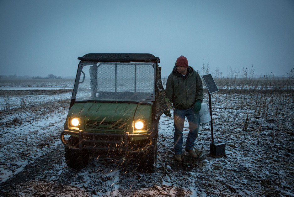 Kyle checks on an electric fence that shorted out when snow laid prairie grass across the wire.