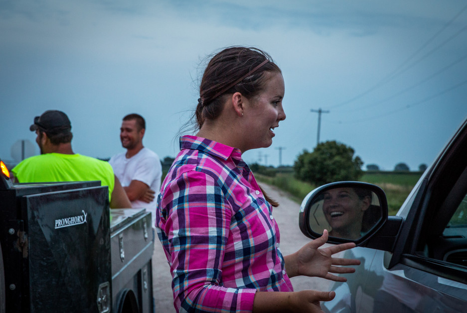 The search for a neighbor's lost dog turns into a social gathering at the intersection of two country roads.