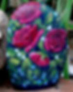 handpainted rocks,roses,yard art,decor