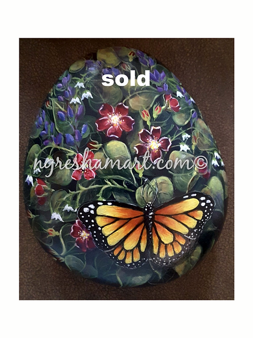 Painted rock flowers and butterfly