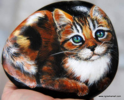 calico cat with green eyes painted rock