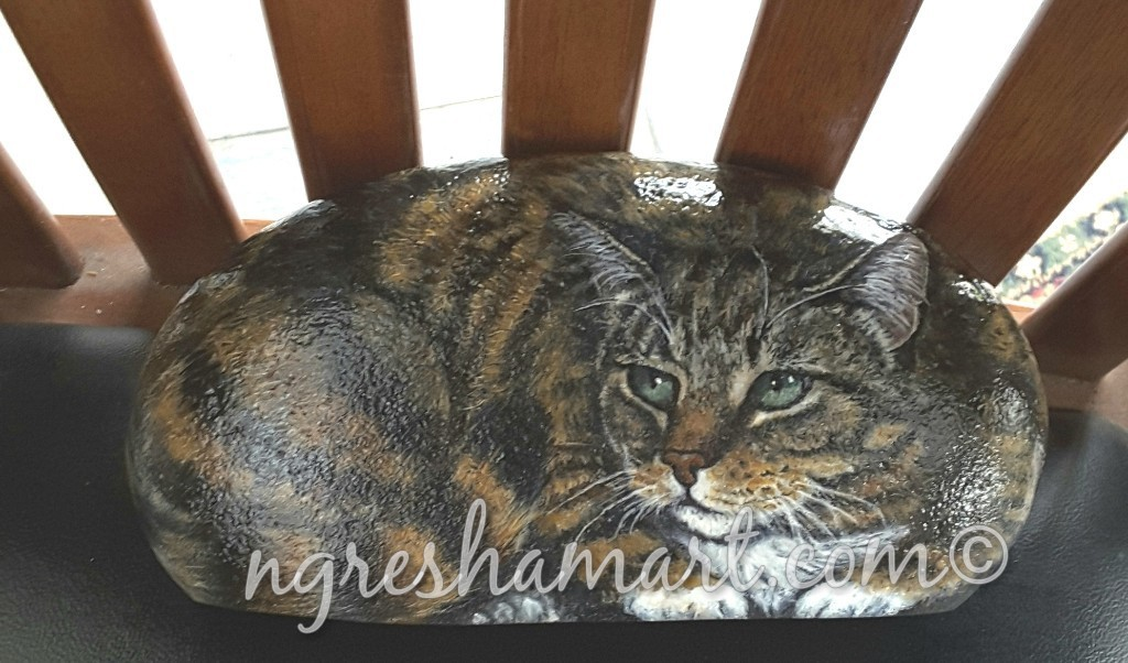 striped cat painted on rock ngreshamart