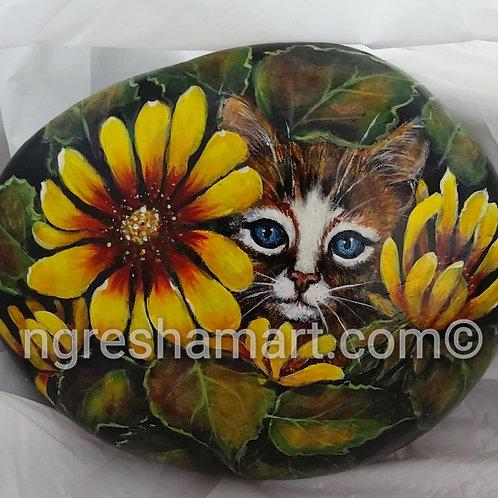 Kitten in the flowers