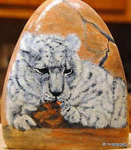 handpainted rocks,leopards,snow leapards painted on rock