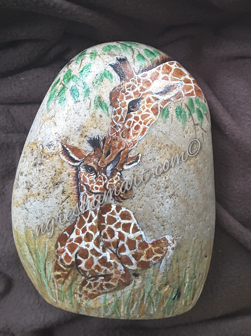 giraffes handpainted on rock