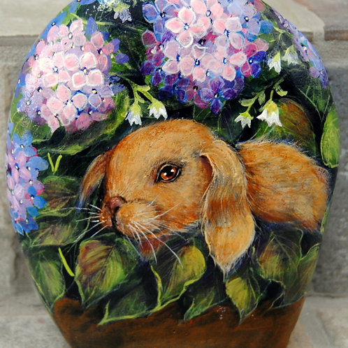 Lop eared bunny surrounded by pretty flowers,handpainted rock pet portrait,stone