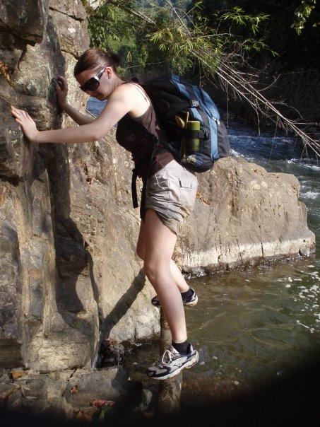 Carefully climbing around a mountain, thailand