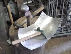 Hammering engine shroud to shape