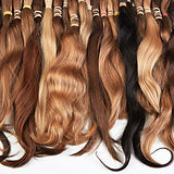 Hair extension equipment of natural hair. Hair samples of different colors.jpg