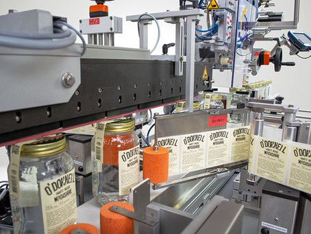 b+b develops fully automatic labelling system for whiskey bottles from O'Donnell Moonshine