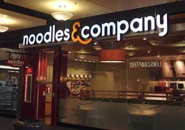 Noodles - interior lighted sign letters installation.jpg