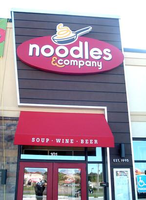 Noodles lighted sign cabinet installation.JPG