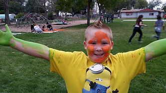 A Kids At Their Best kid with face paint on