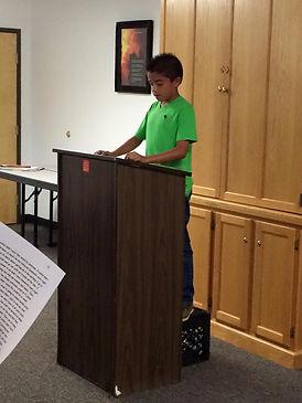 A Kids At Their Best child making a speech