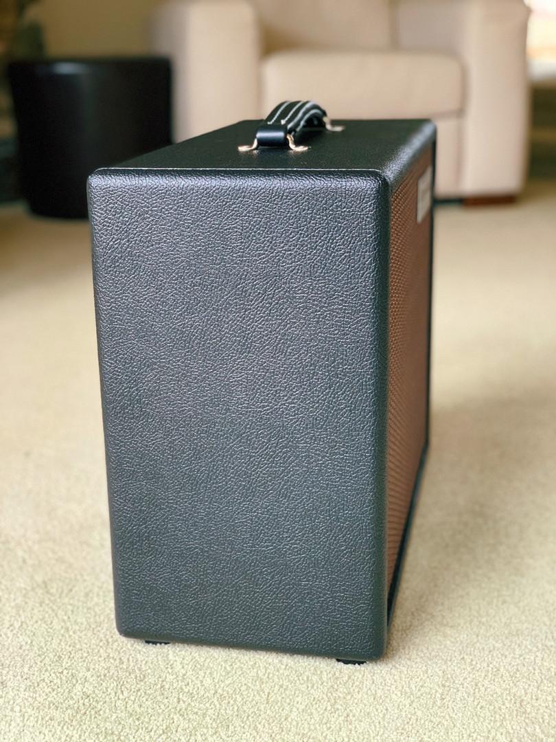 "Butterfield Speaker Cabinet with 12"" Jensen Speaker in Classic Pebble Black Tolex with Oxblood/Gold grill."