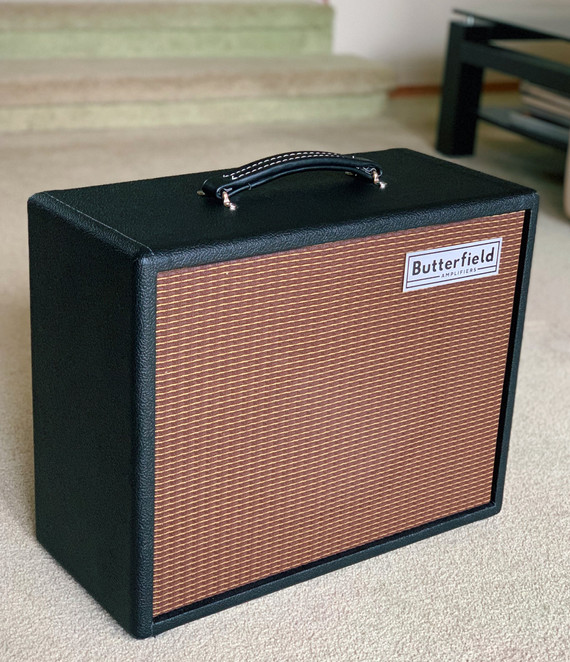 "Butterfield Speaker Cabinet with 12"" Jensen Speaker in Classic Pebble Black Tolex with Oxblood/Gold grill."