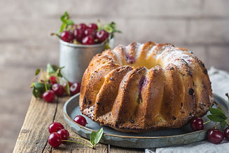 Fresh homemade bundt cake with cherry on