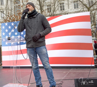 Director shot on stage-Freedom Rally Jan