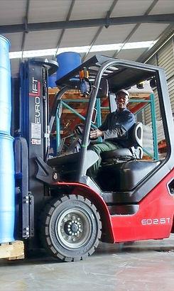 nutrochem employee driving a forklift