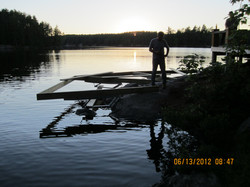 Sunrise Over a Dock On A Rock