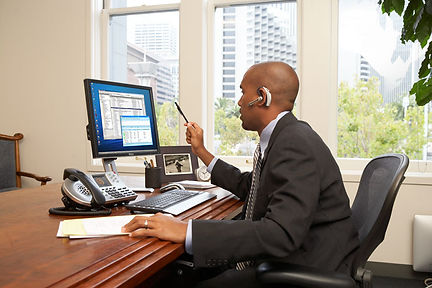 Integral Networking executive using ShoreTel phone