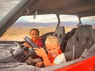 Two kids having fun on a desert tour in Arizona